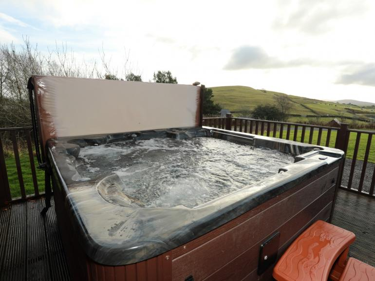 Relax and unwind in the spacious private hot tub
