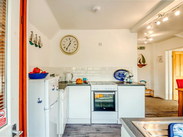 Enter into the kitchen