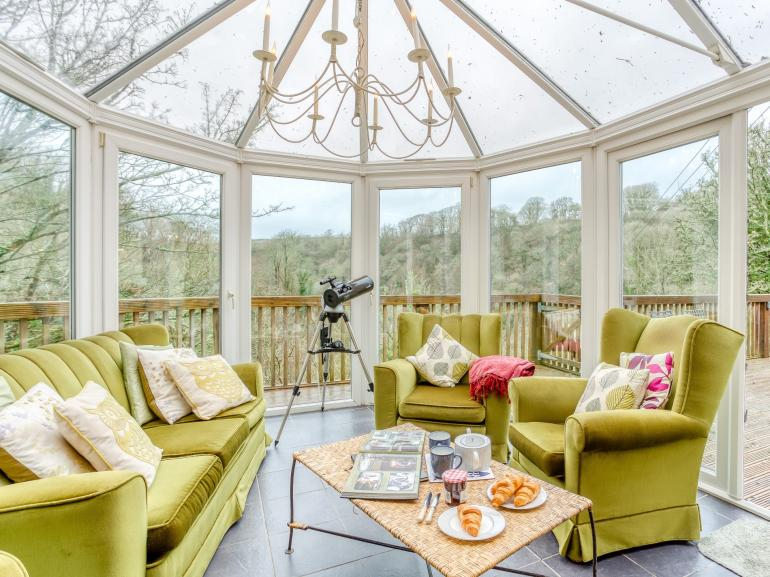 Beautiful conservatory overlookimg the stunning woodland