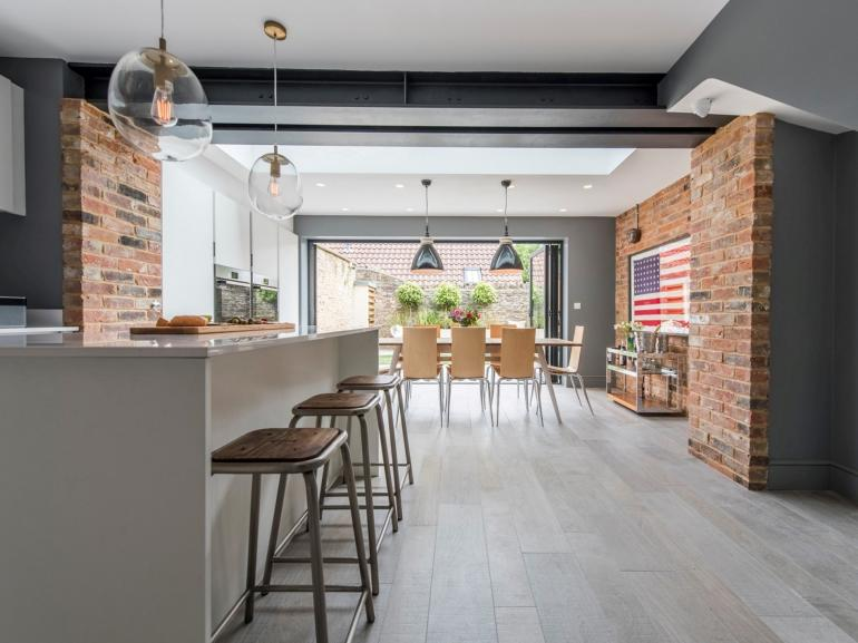 Stylish open-plan kitchen/diner which leads out to the private garden area
