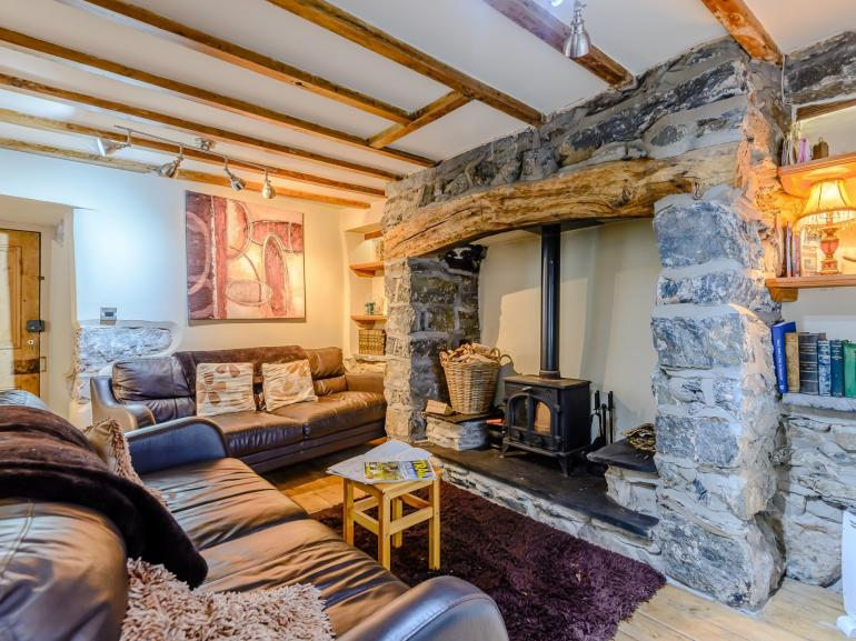 Beautiful stone cottage with exposed beams and feature fireplace