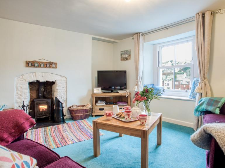 Cosy sofas, wood burner and TV