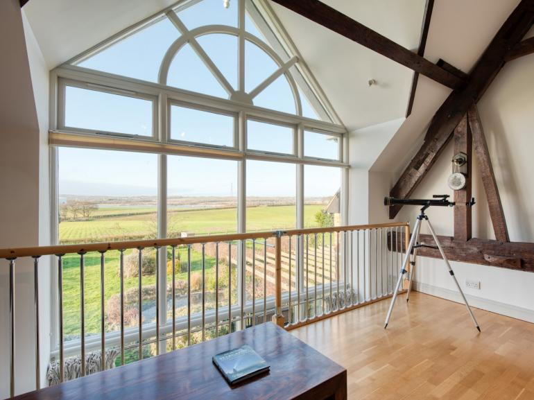 The mezzanine is a great space to sit and take in the views of the countryside and beyond over the river