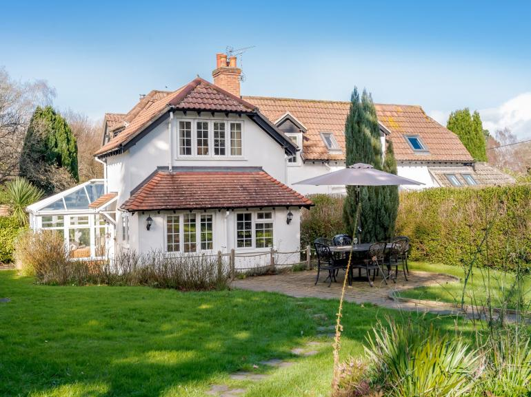 A beautiful garden surrounds this cosy country cottage