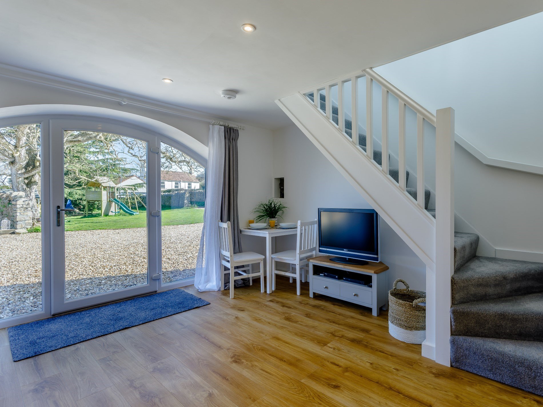 Head up the stairs to the king-size bedroom
