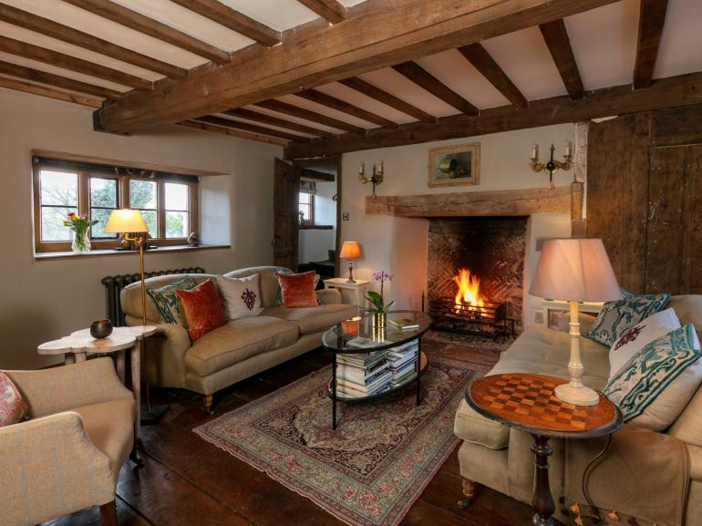 Relax and enjoy the open inglenook fireplace