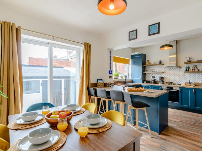 The chic and colourful kitchen diner is the perfect social space