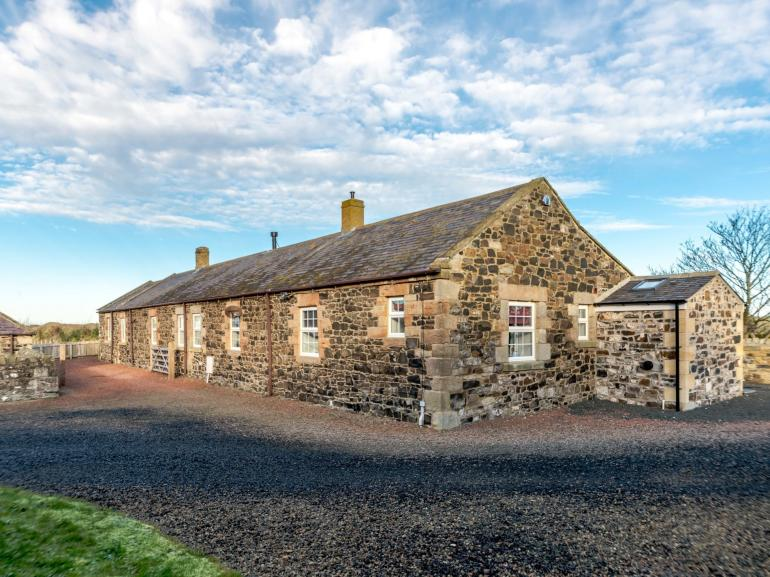 View of this lovely stone cottage with dune views