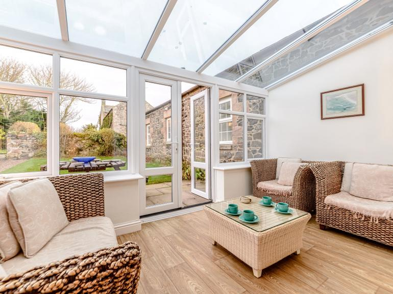 Relax in the cosy conservatory with a coffee