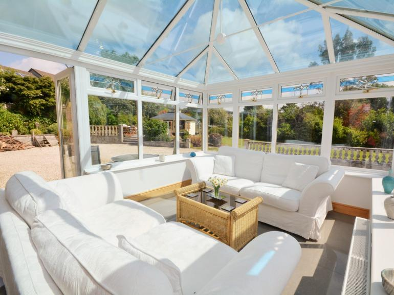 Spacious conservatory with access to the garden