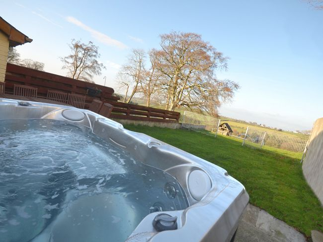 Enjoy the private hot tub with countryside views