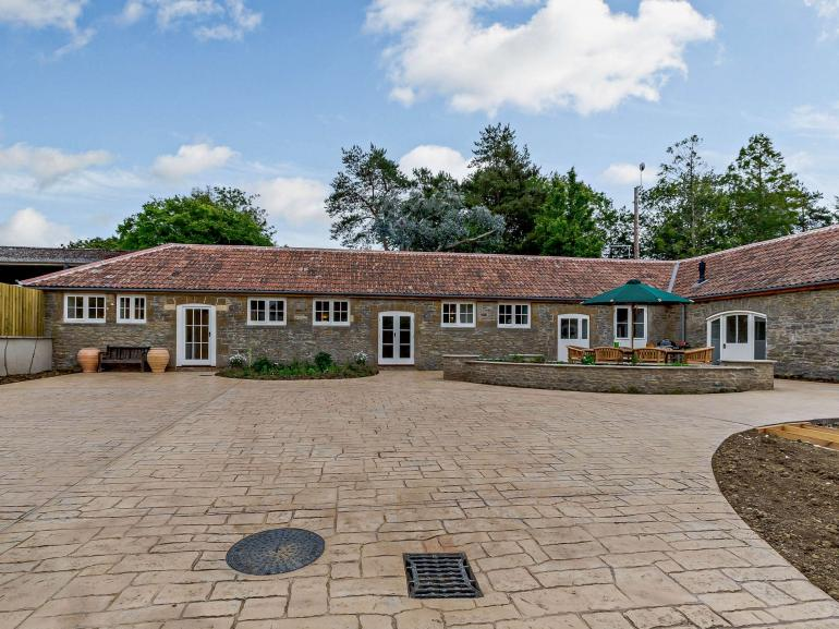 Looking towards the stylish property and annexe from the enclosed courtyard