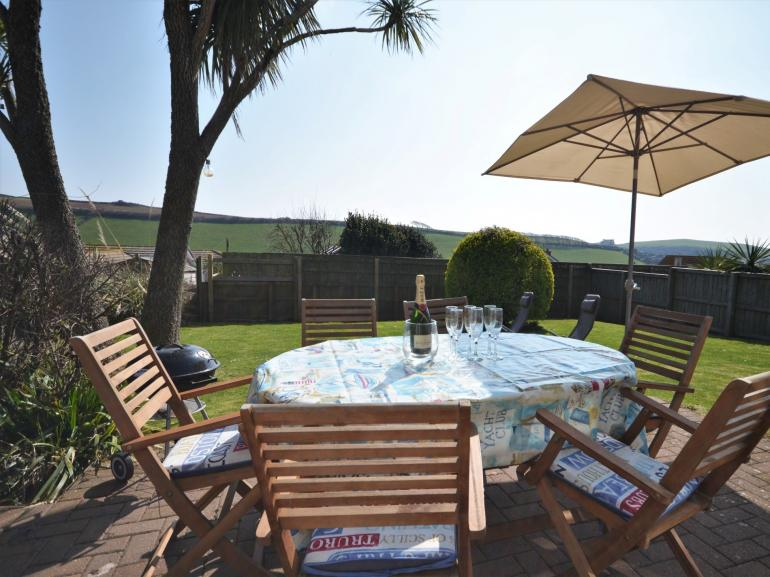Patio area with garden furniture and enclosed garden