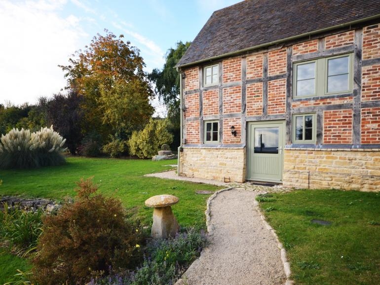 Beautiful converted cottage with original exposed beams which is attached the main farmhouse