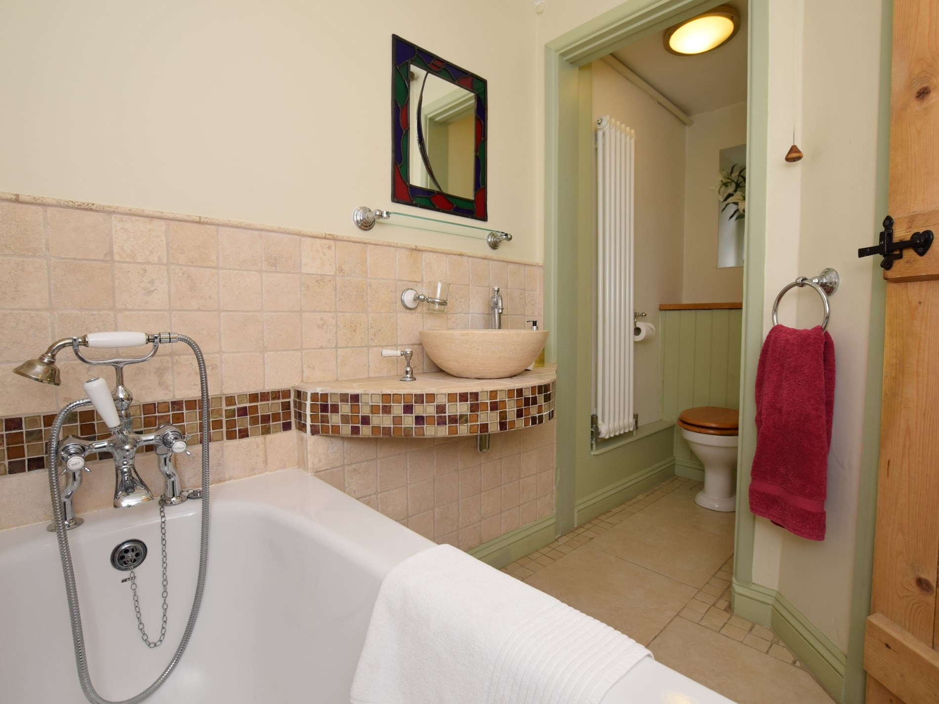 Downstairs bathroom with WC and shower over bath