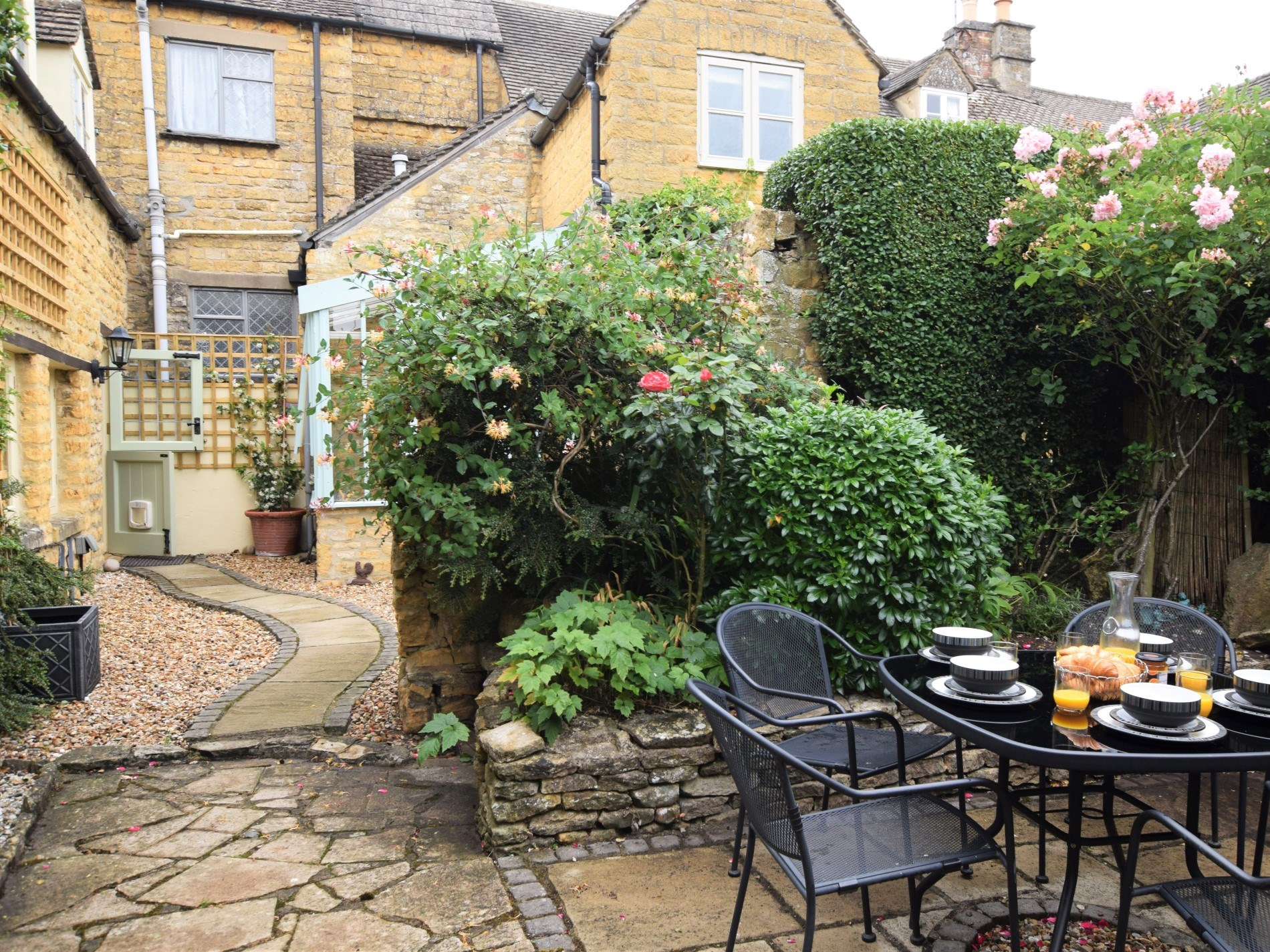 Relax in the pretty enclosed patio with seating