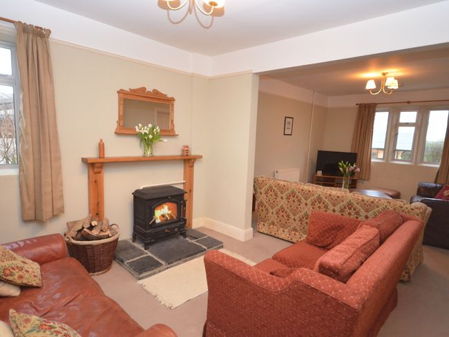 Spacious lounge with woodburner