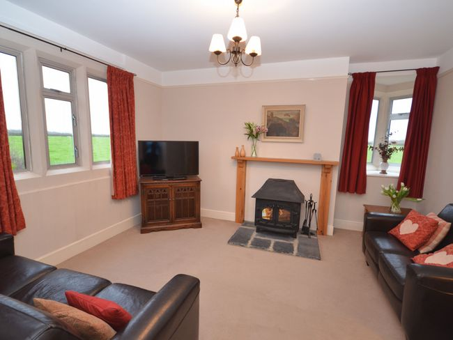 Cosy 2nd lounge with woodburner