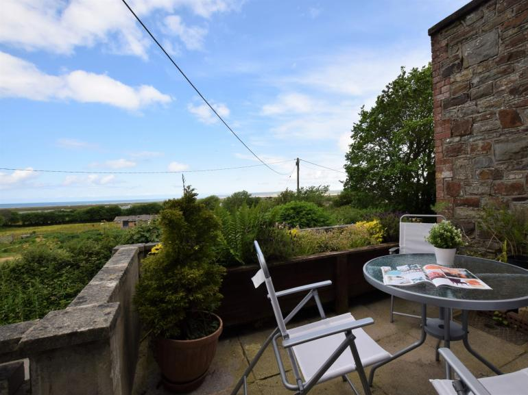 Dine al fresco with distant sea view