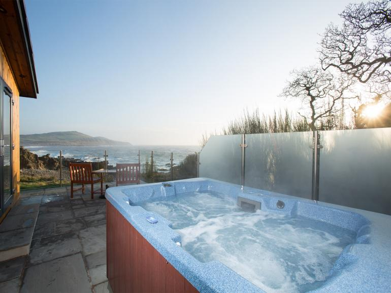 Stunning views from private hot tub at sunrise