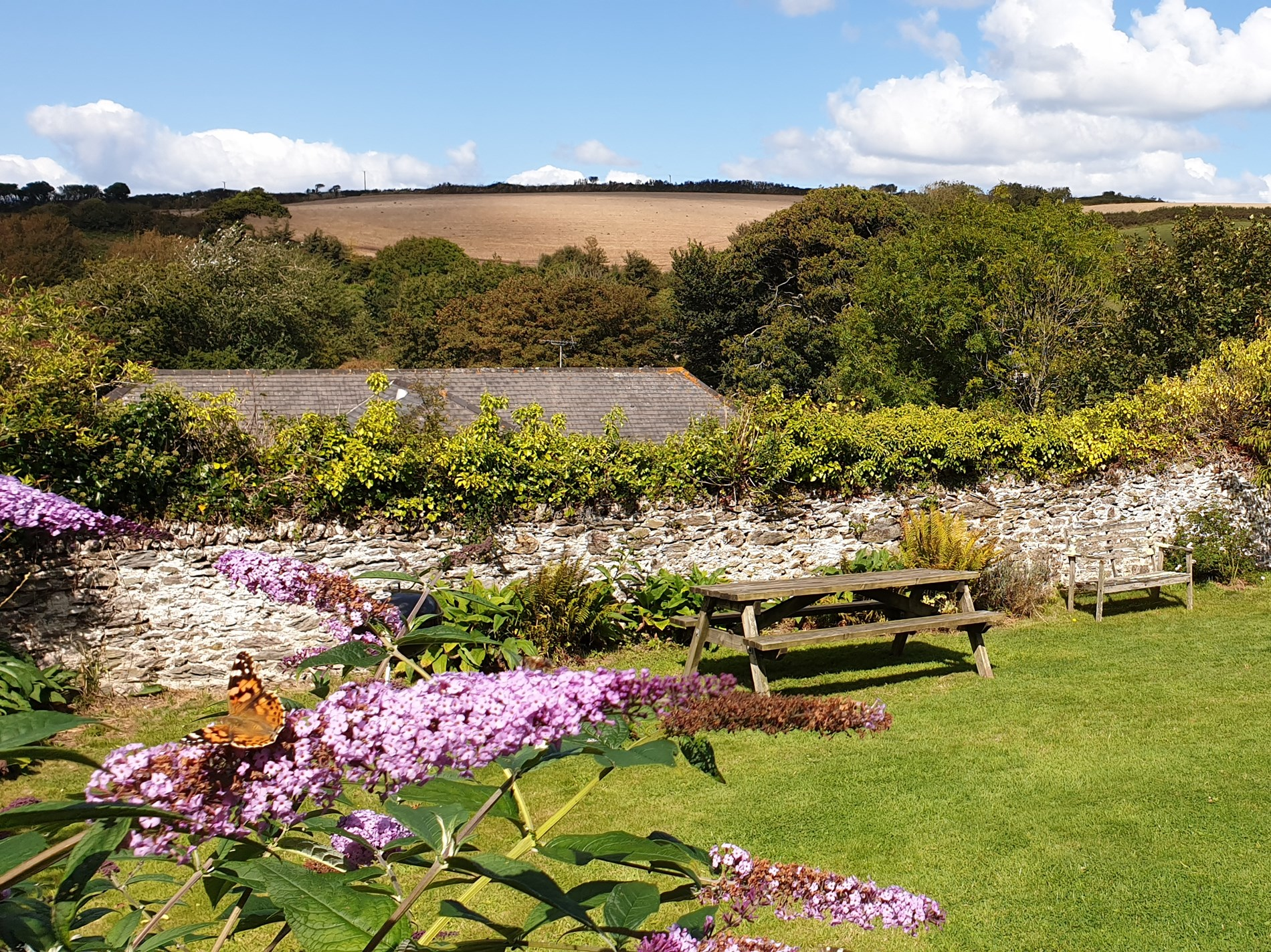 Shared garden with seating and views across the countryside