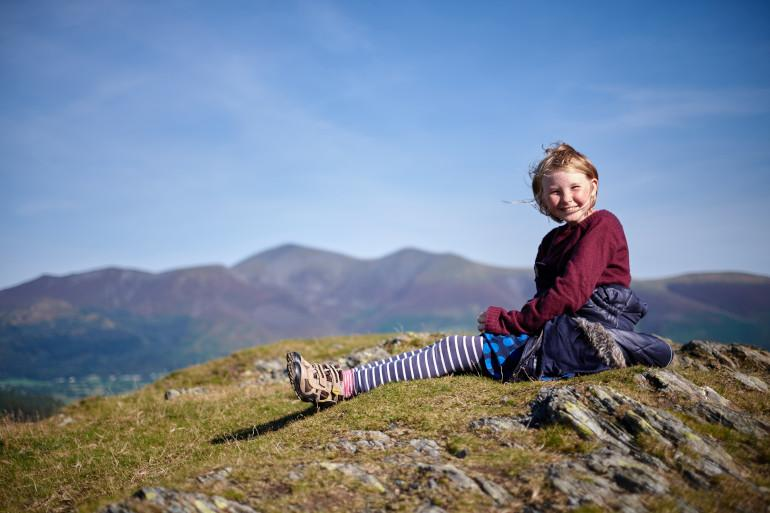 Young girl in Lake District on mountain
