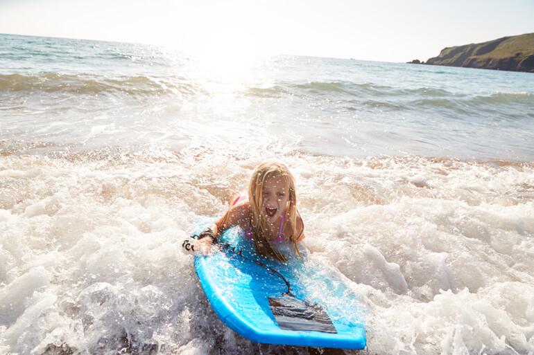bodyboarding on the beach