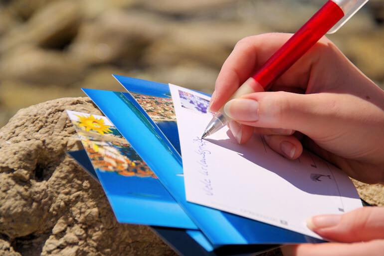 Beach activities - Writing postcards