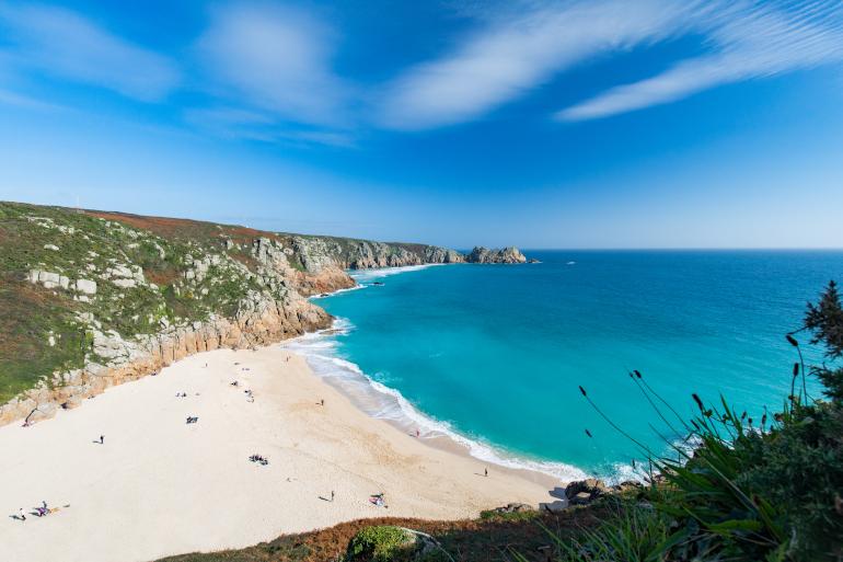 Pedn Vounder beach in Cornwall - sandy beach surrounded by cliffs