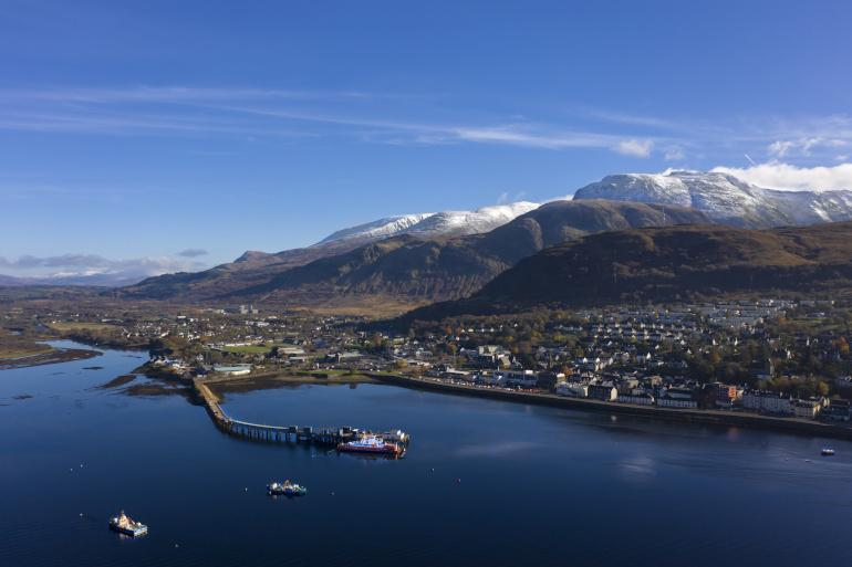 An aerial view of Fort William with Ben Nevis behind