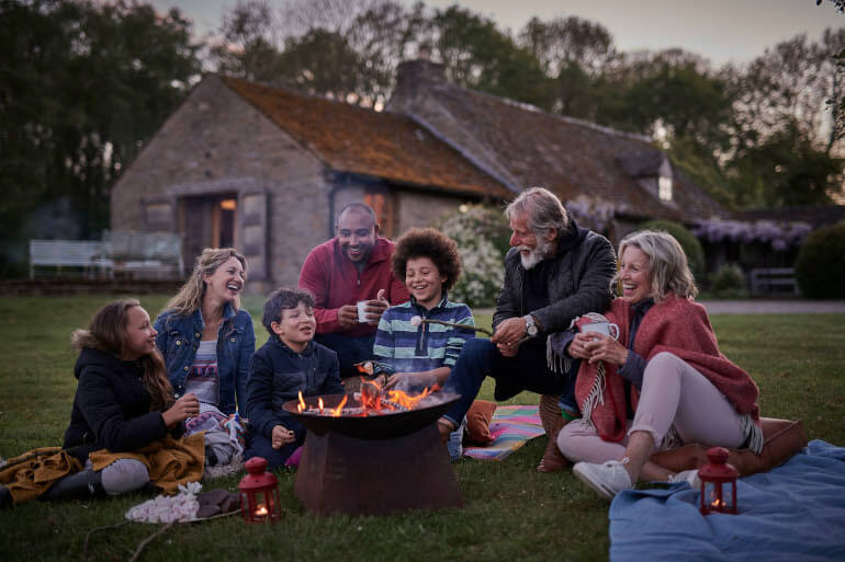 Family around firepit