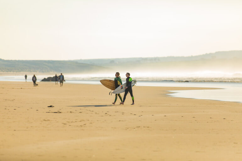 Surfers on Cornish beach