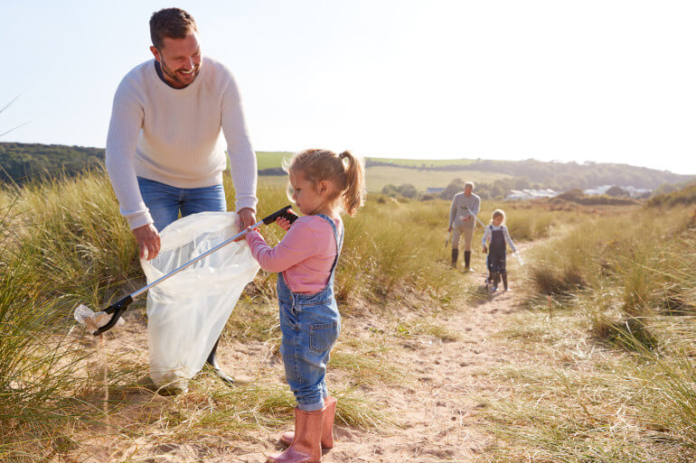 Family on a beach clean