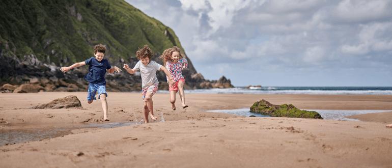 Kids on a beach scavenger hunt
