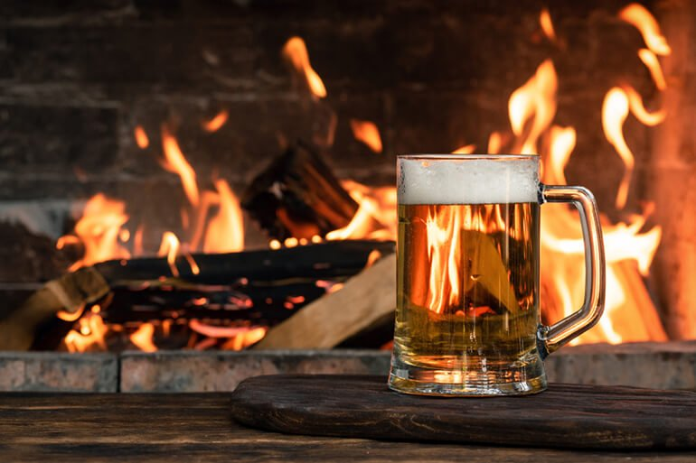 Enjoy a drink in front of a fire at The Percy Arms