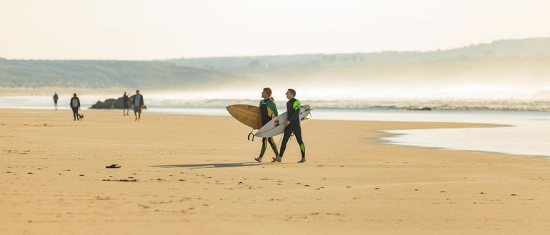 Surfers on a beach in Cornwall
