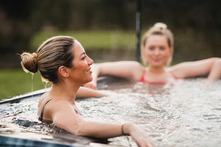 Friends relaxing in a hot tub