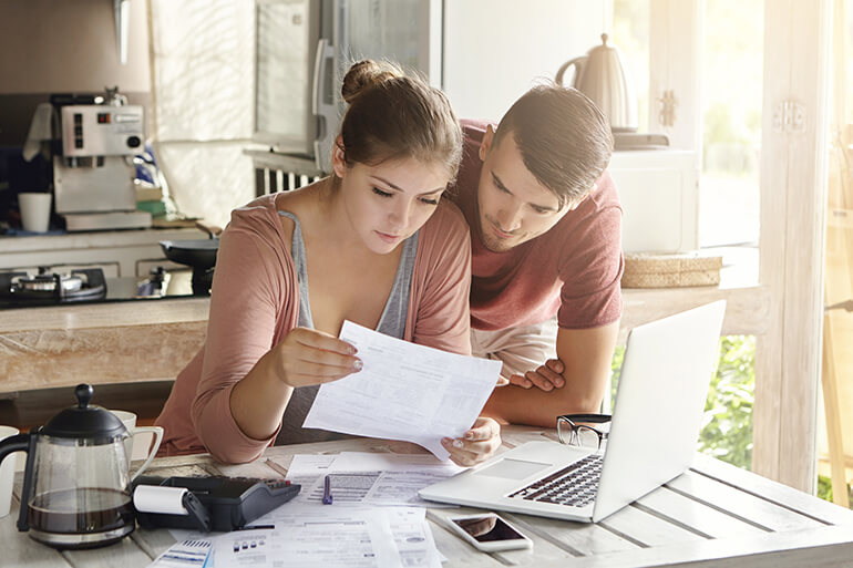 Couple studying their taxes