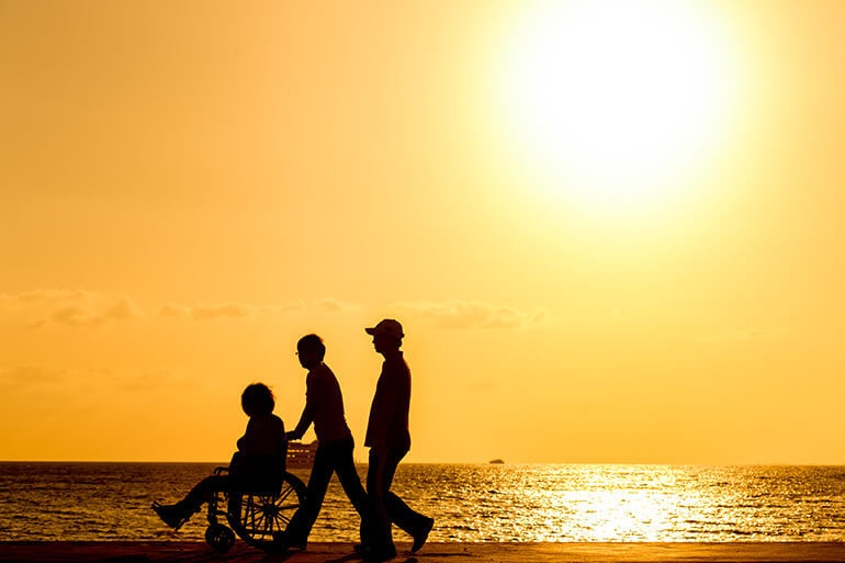Sunset walk by the sea in a wheelchair