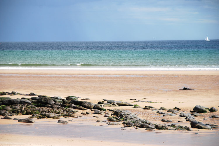 beautiful blue sea and golden sand of Beadnell Bay