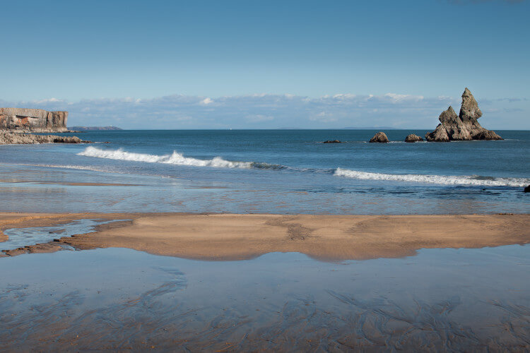 Blue waters and Church Rock at Broad Haven South