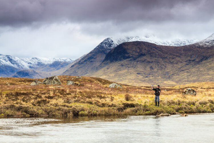Fishing on a river in the Scottish highlands
