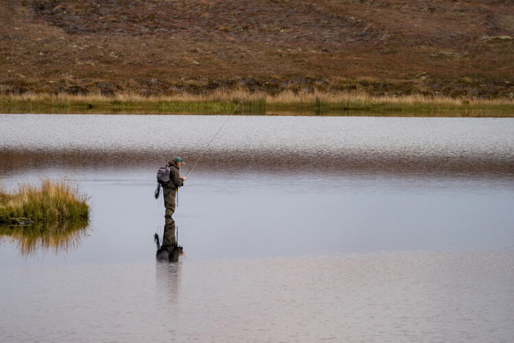 Fisherman on a remote loch in Scotland