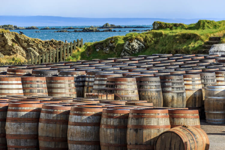 Whisky barrels lined up on the Isle of Islay