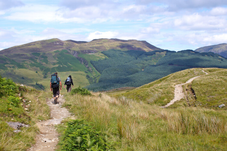 walking through the hills in the Scottish Highlands