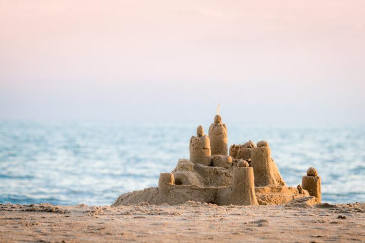 Build sandcastles on a Northumberland beach