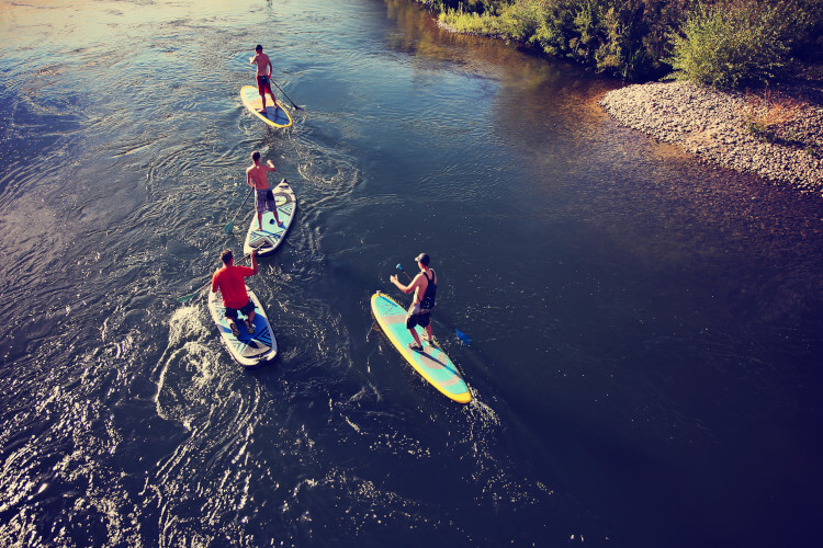 Try paddle boarding in Northumberland and see the landscape from a different angle