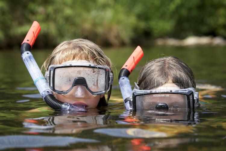 Kids wild swimming in Northumberland