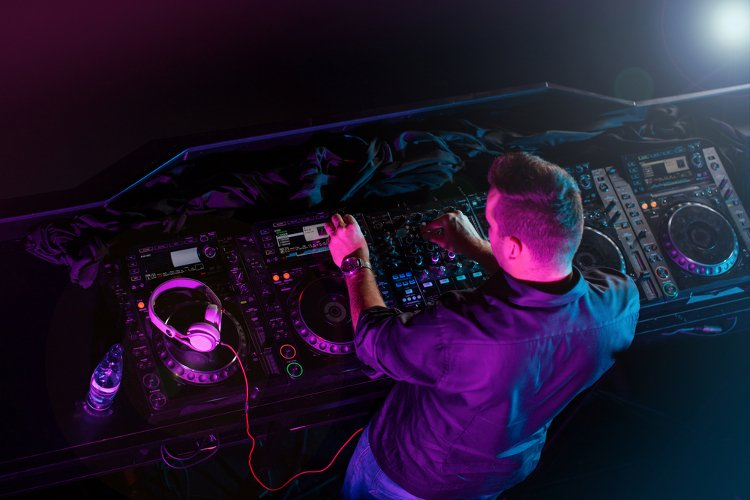 DJ playing music on a pair of decks