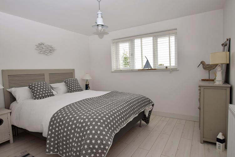 Bedroom at Pevensey Bay Beach Retreat dog-friendly cottage in East Sussex